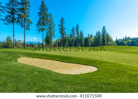 Sand bunkers at the gorgeous golf course. - stock photo