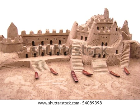 sand castle against white