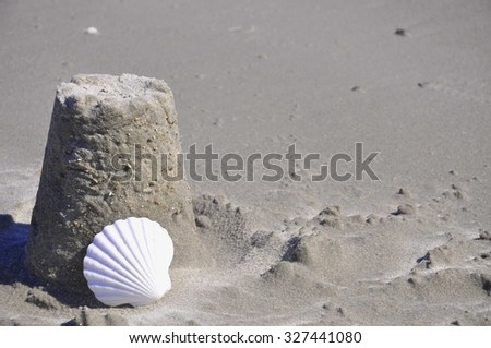 Sand Castle and shell, room for your text - stock photo