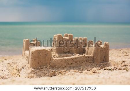 Sand Castle on Beach  - stock photo