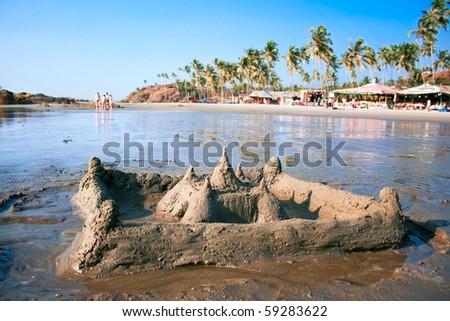 Sand castle on  beautiful tropical Vagator beach, Goa, India - stock photo