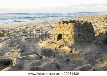 sand castle on the beach - stock photo