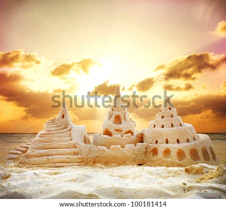 Sand Castle on the Beach over Sunset  Background - stock photo