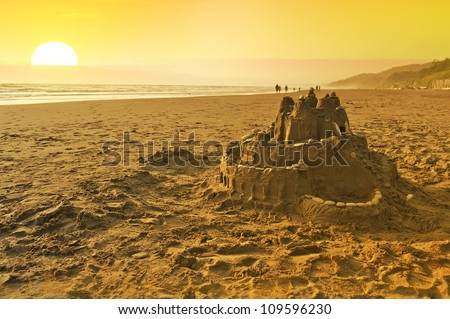 Sand Castle on the Beach. Summer Fun on the Beach of Washington State. Pacific Ocean and the Sunset. Playing with Sand - Sand Castle. - stock photo