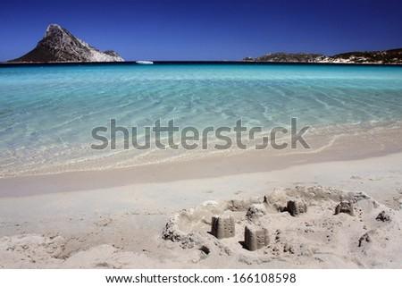 Sand castle on tropical white sand beach. - stock photo