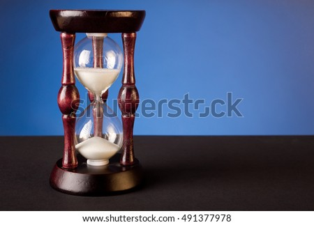 sand clock on blue background