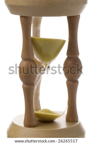 sand clock showing how is time passing on white background - stock photo