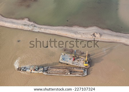sand dredger on barge on Nysa lake in poland - stock photo