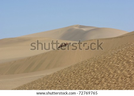 Sand dune and camel train