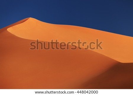 Sand dune in Sahara Desert at sunset, Algeria - stock photo