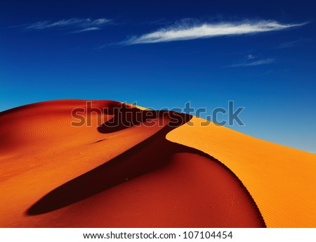 Sand dune in Sahara Desert at sunset, Tadrart, Algeria - stock photo