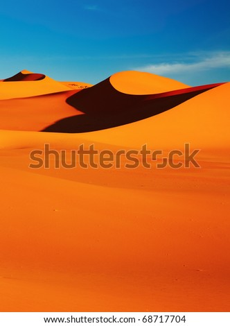 Sand dune in Sahara Desert at sunset, Tadrart, Algeria - stock photo