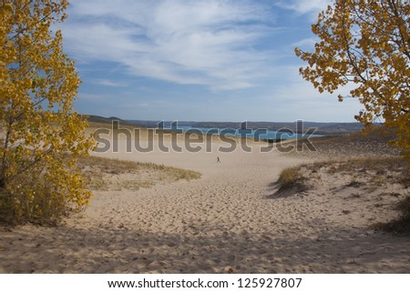 Sand dune in the autumn, with hiker in distance