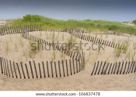 Sand dune protection fence against erosion - stock photo