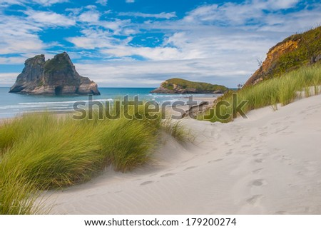 Sand Dunes and Grass Vegetation at Famous Wharariki Beach, - stock photo