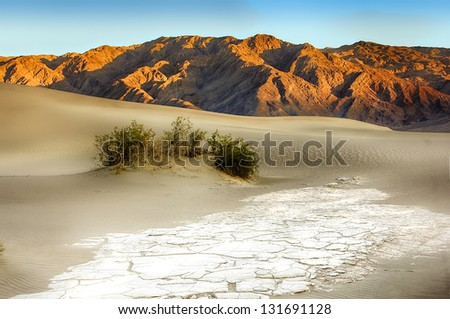 Sand Dunes And Mountains At Death Valley National Park, California, USA - stock photo