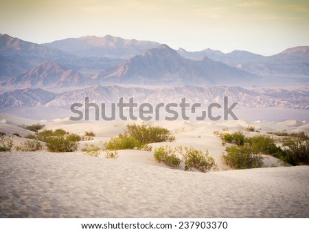 Sand Dunes And Mountains in sunset, Death Valley National Park, California, USA - stock photo