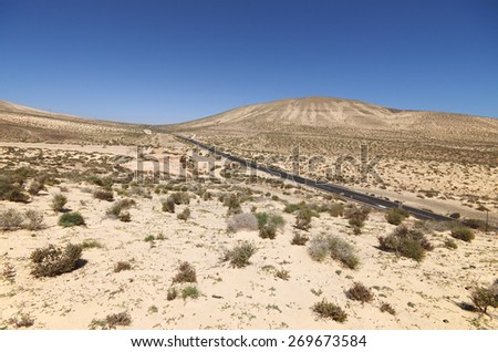 Sand dunes and mountains near Sotavento beach on Jandia peninsula, Fuerteventura, Canary Islands, Spain - stock photo