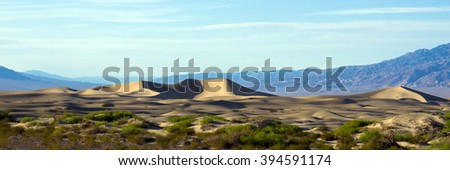 Sand dunes at sunset in Death Valley National Park - stock photo