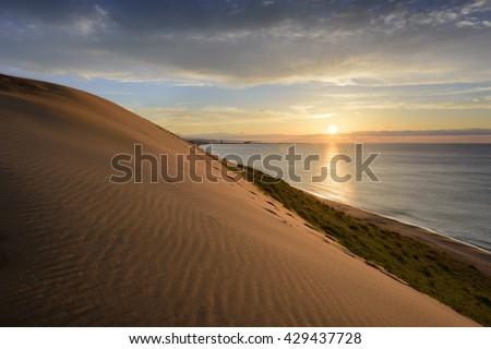 Sand dunes at Tottori, Japan along the Sea of Japan. - stock photo