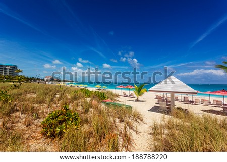 Sand dunes behind a stretch of the long Grace Bay Beach, Providenciales, Turks and Caicos Islands