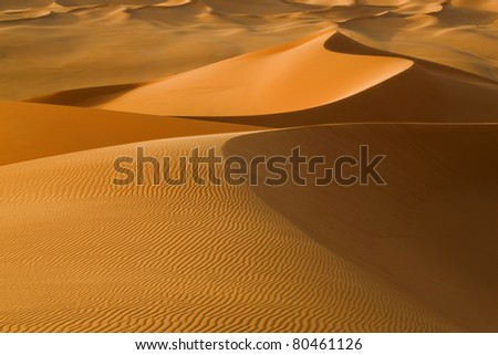 Sand dunes in the Sahara Desert, Libya. - stock photo
