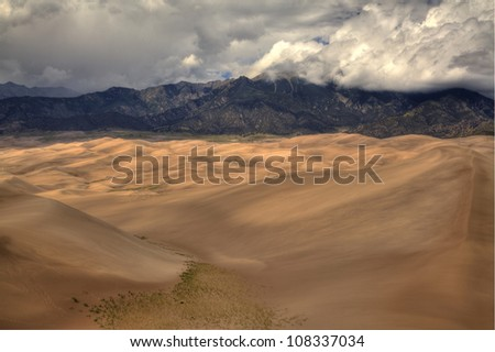 Sand Dunes National Park in late afternoon storm light - stock photo
