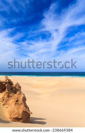 Sand dunes near to the ocean with cloudy blue sky, Boavista, Cape Verde  - Cabo Verde - stock photo