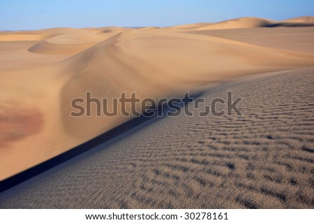 Sand dunes on Skeleton coast in Namibia - stock photo