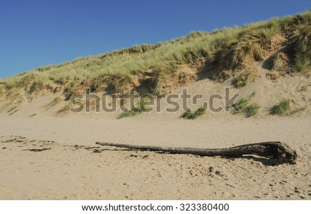 Sand Dunes on the Beach at Woolacombe Beach on the North Coast of Devon, England, UK - stock photo