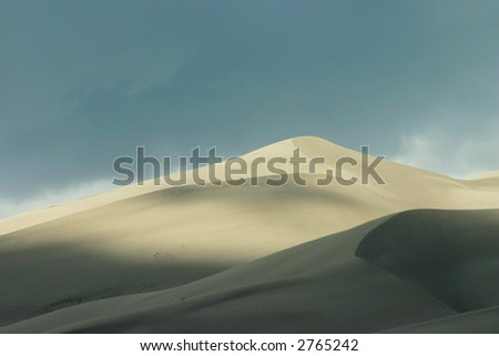 Sand Dunes with Cloudy Sky and Shadows