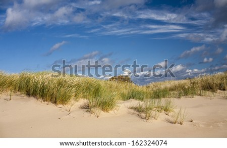 Sand dunes with skyline - stock photo