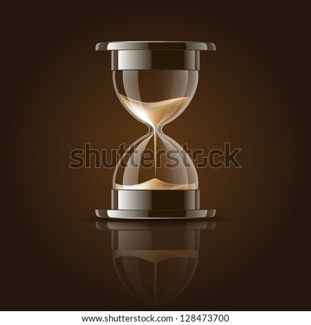 Sand falling in the hourglass on dark background - stock photo