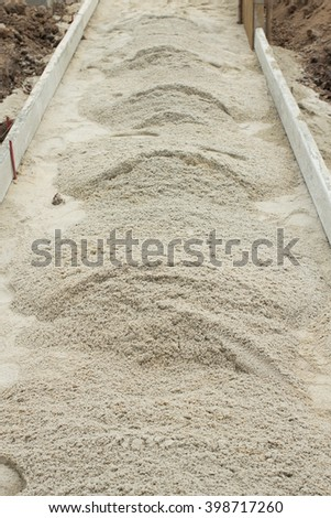 Sand foundation at the construction site.Sand pile for construction. - stock photo