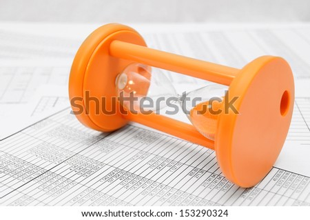sand-glass and documents. - stock photo