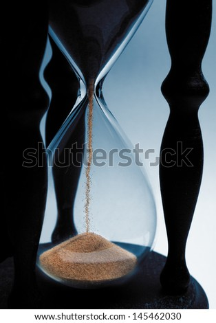 Sand-glass detail counts time. - stock photo