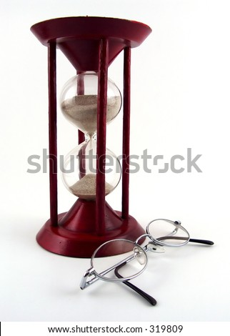 sand glass with glasses - stock photo