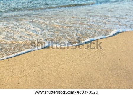 Sand golden beach with blue wave blank background