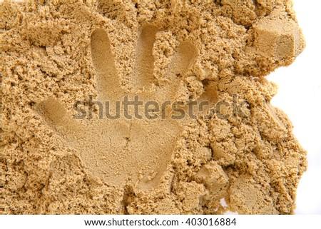 sand hand print as nice human background - stock photo