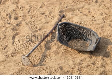 sand hand tool - stock photo