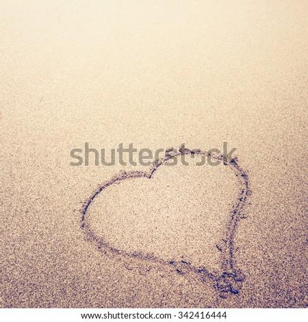 Sand heart - stock photo