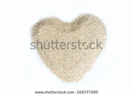 Sand heart shaped isolated on white background - stock photo
