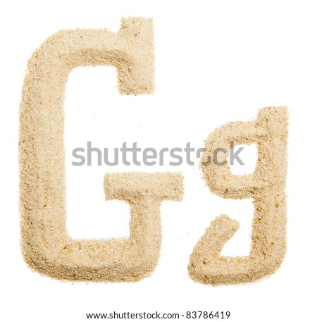 Sand letter isolated on white. One letter of Sand alphabet. Letter G