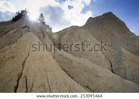 Sand mountains as result of open cast mining - stock photo