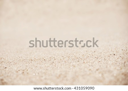 Sand on the beach background, tilt-shift technique