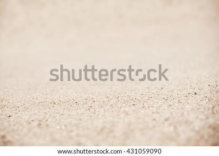 Sand on the beach background, tilt-shift technique - stock photo