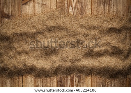 Sand on wooden table - stock photo