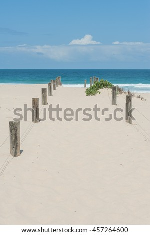 Sand path to the beach - stock photo