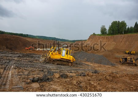 Sand pit. Sand special for construction. Pit full of fine sand and truck tracks. Gold mining