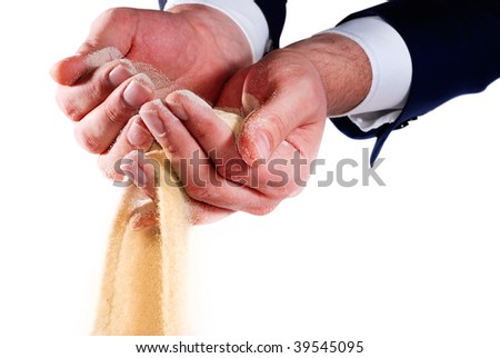 sand pouring out of businessman hands - stock photo